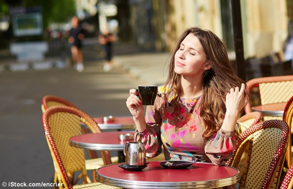 Beautiful young woman in a Parisian cafe